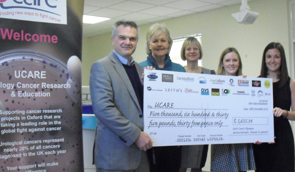 Presenting a cheque to UCARE